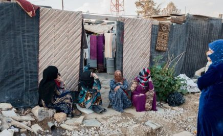 Four woman sitting in a refugee camp in Lebanon