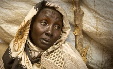 A woman from South Kordofan Sudan in a displaced camp, crying.