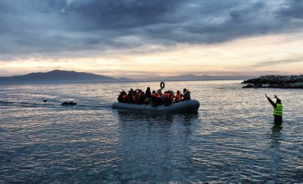 Refugees and migrants on an inflatable boat arrive in Greece.