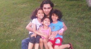 Raif Badawi with his kids