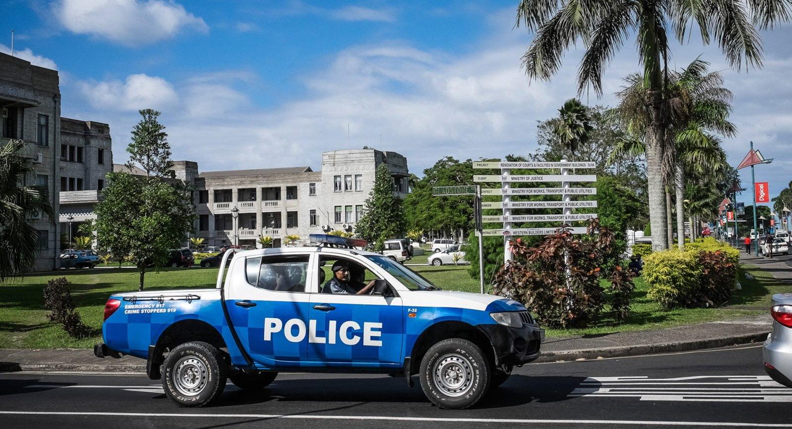 A Fijian police car in a busy street