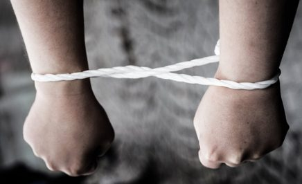 Arms bound by rope