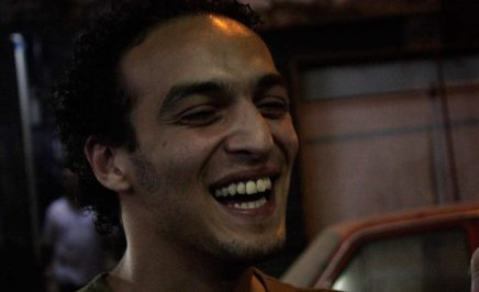 Mahmoud Abou Zeid, also known as Shawkan, laughs at the camera.