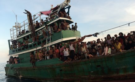 Rohingya migrants sit and stand on a boat drifting in Thai waters off the southern island of Koh Lipe in the Andaman sea on May 14, 2015. A boat crammed with scores of Rohingya migrants -- including many young children -- was found drifting in Thai waters on May 14, with passengers saying several people had died over the last few days.