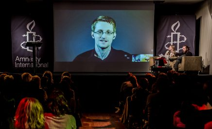 Edward Snowden appearing via video link at an Amnesty International event
