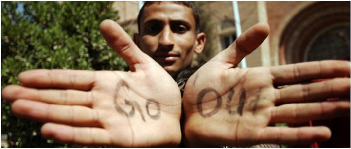 A man holding out his hand. The words 'go' and 'out' are written on his palms