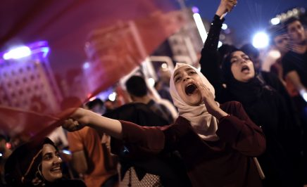 Supporters gather at Taksim square in Istanbul, waving flags and shouting to support the government following a failed coup attempt.
