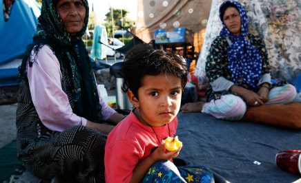 A young Afghan boy and his family who have been living in the old airport of Elliniko, Athens for five months