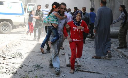 A family run through rubble in Syria searching for safety