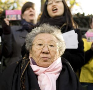 "Gil Won Ok was promised factory work at the age of 13, but found herself in a comfort station in northeast China where she worked as a 'comfort woman'. Gil broke her silence in 1998, 53 years after her traumatic experience. She said of the need to continue campaigning: ""the Japanese Government thinks if all 'comfort women' die, it will be buried and forgotten…as long as our next generation knows about it, it will not be forgotten""."