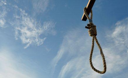 A hangman's noose against a blue sky