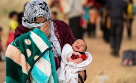 A young mother fleeing Syria with her baby