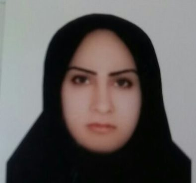 A woman wearing a black head scarf stares at the camera. The background behind her is white.
