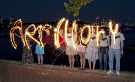 Activists spell out the word artillery with sparklers