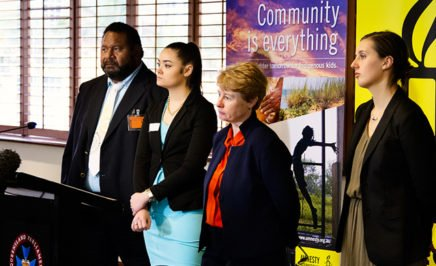 Randall Ross, Justice King, Claire Mallinson and Roxanne Moore stand behind a lectern at the press conference.