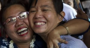 Family members welcome student protest leader Phyoe Phyoe Aung (R) as she arrives for a hearing at her trial in Tharrawaddy town, Bago Region in Myanmar on April 8, 2016. © YE AUNG THU/AFP/Getty Images