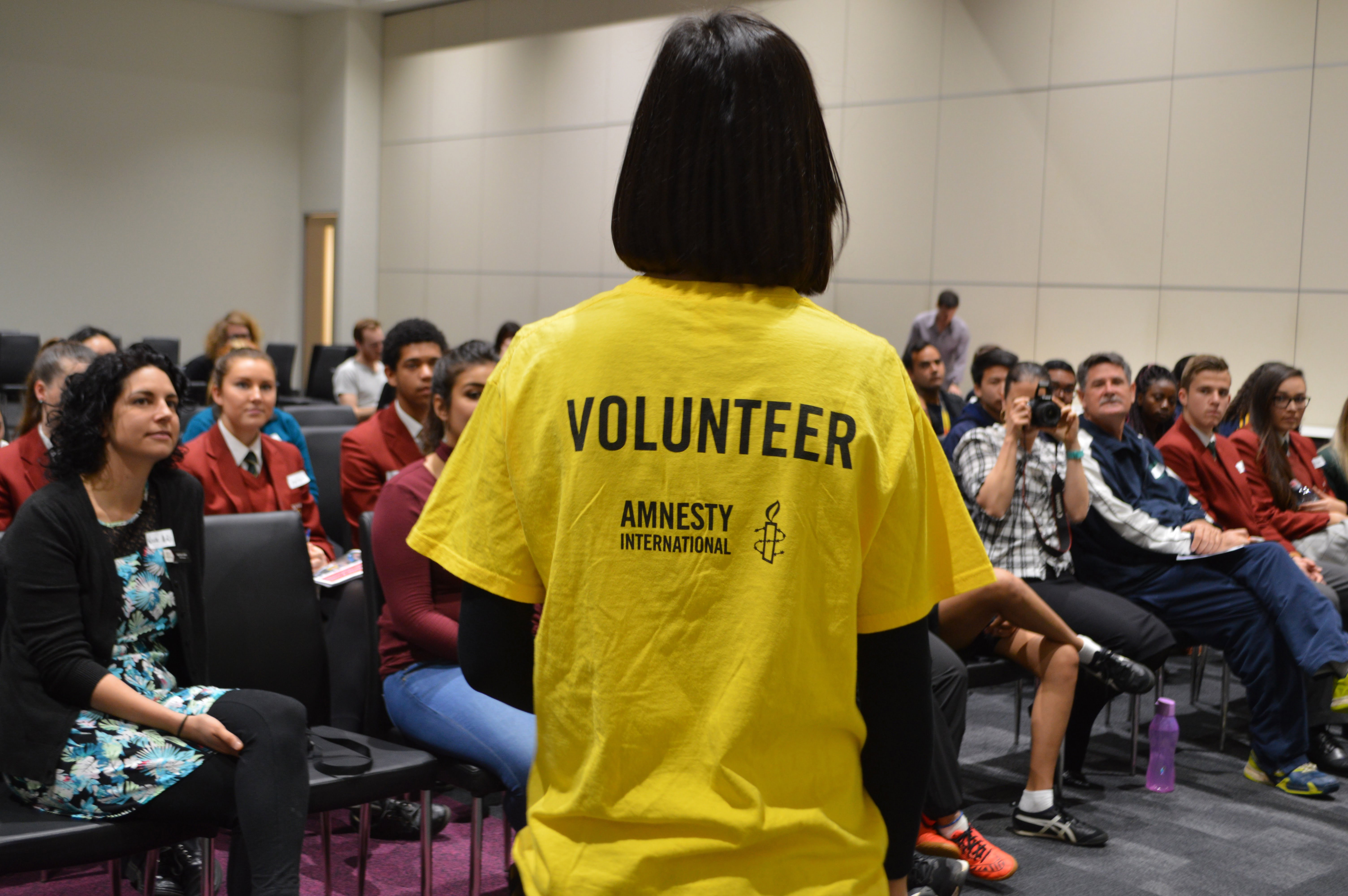 An Amnesty volunteer with students at the SA/NT Schools Congress. © Private
