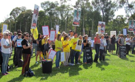 Supporters of Amnesty International Australia and the Refugee Action Committee Canberra at Parliament House lawns oppose the proposed Lifetime Ban bill.