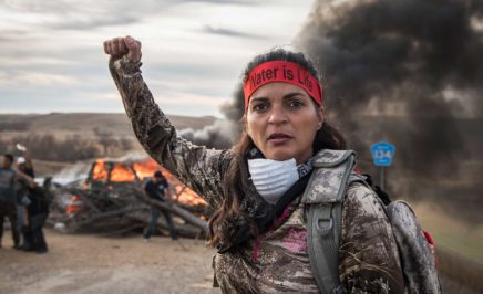 A Field Medic wearing camo and a red headband that reads:
