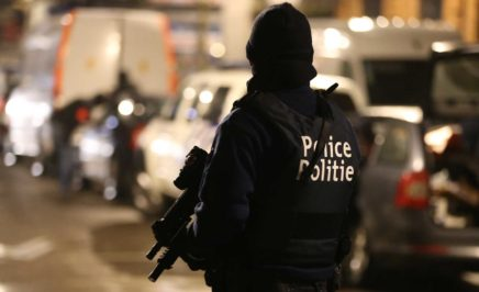 Police officers take part in an operation in Brussels
