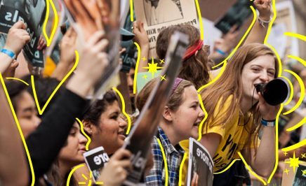 A line of young impassioned women protesting at a rally with raised fists and megaphones. The women are outlined by yellow lines.