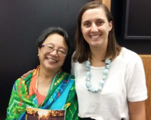 Indigenous Rights Campaigner Roxanne Moore with the UN Special Rapporteur on the Rights of Indigenous Peoples, Victoria Tauli-Corpuz, holding the Community is Everything 'Heads Held High' report. © AIA 2017