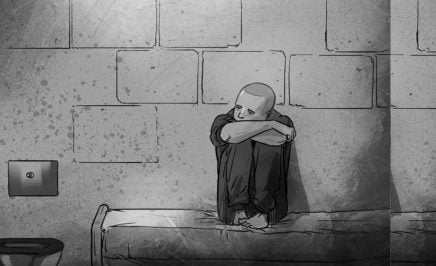 A photo of a black and white illustration of a child sitting on a bed in a prison cell, resting his head on his knees.
