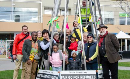 The Tasmanian Refuegee Group, volunteers and members of the public in front of the Welcome Refugee Tree
