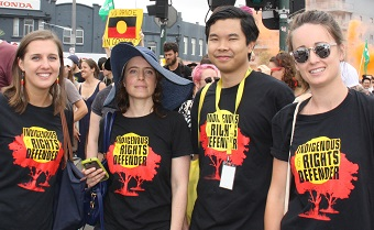 Activists wearing Indigenous rights defender tshirts at a Survival Day rally 2017