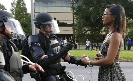 JULY 11 2016 SAVE PRINT LICENSE ARTICLE 'Remarkable' photo of woman facing riot police that may define Black Lives Matter Megan Levy Black Lives Matter reeling after police shootings Dallas shootings compound horror for Americans Who was Micah Johnson, the Dallas shooter? As the lone woman stood in front of a row of riot police in the US, her flowing dress and bare arms in sharp contrast to the officers' armour, she gave off an air of peaceful determination and defiance. Play Mute 0:00 / 0:00 Loaded: 0%Progress: 0% Fullscreen MORE WORLD NEWS VIDEOSPrevious slide Next slide null Black Lives Matter photo goes viral null Video duration 01:03 British actor's ISIL Ariana Grande revenge Myeshia Johnson kisses the casket of her husband, Sgt. La David Johnson during his burial service at Fred Hunter's ... Video duration 01:49 Widow says Trump call 'made me cry' Video duration 00:49 Toys 'R' Us collapse to hit Hasbro ... null Video duration 01:40 Five former US presidents join forces null Video duration 02:13 I don't know how to get through to you: ... null Video duration 01:44 Japanese election risk pays off for Abe null Video duration 01:12 Tillerson: militias in Iraq should 'go ... MORE VIDEOS Black Lives Matter photo goes viral The image of a lone woman in a dress standing up to riot police at a protest in Baton Rouge is being hailed as