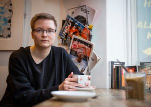 Sakris Kupila a 20 year-old medical student, a youth activist and a defender of transgender rights from Finland. sits in a coffee shop.