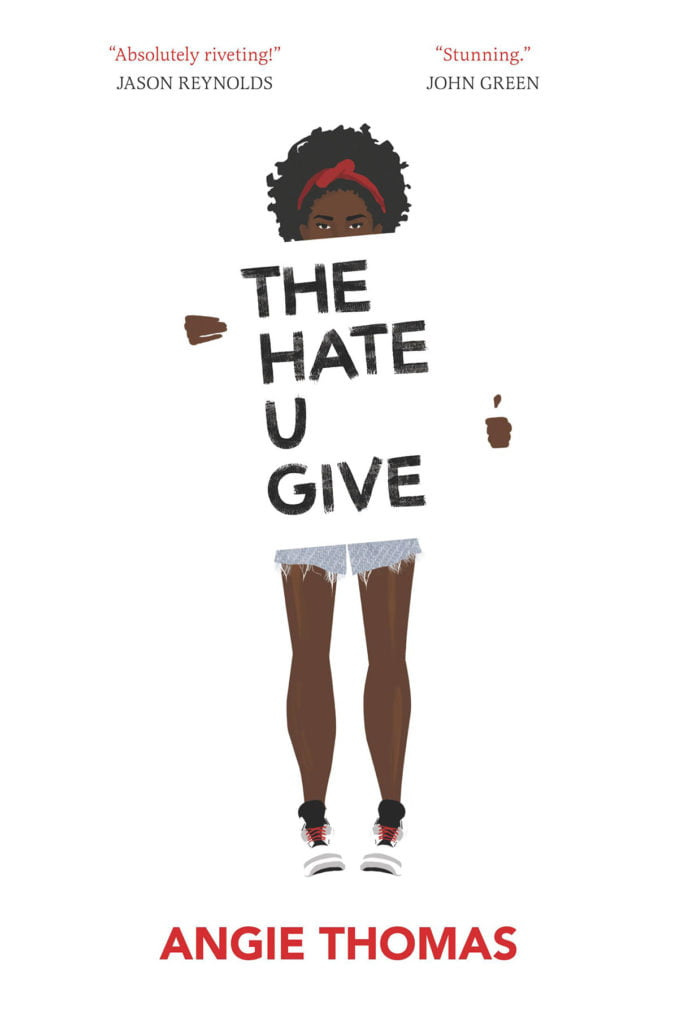 The front cover of the book 'The Hate U Give'. It features a black girl holding a sign with the title of the book written across it.