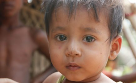 Rohingya baby girl looking into the camera