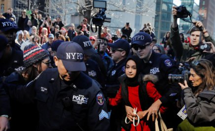 NYPD officers arrest a woman who was taking part in a 'Day Without a Woman' march. © Lucas Jackson/REUTERS