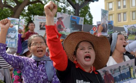 Cambodian land rights activists shout slogans during a protest in front of the Phnom Penh municipal court on August 22, 2016 to demand the release of two prominent activists who were sentenced to six days in jail.