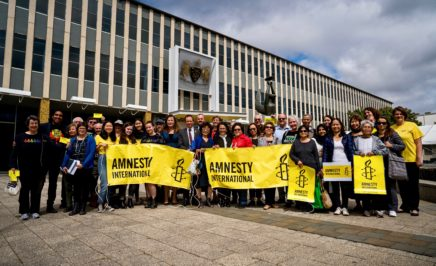 (c) AIA/ Benjamin Murphy: Amnesty ACT activists, MLAs, refugees and staff celebrate ACT community sponsorship motion.
