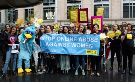 Amnesty staff and activists with banners and props targeting Twitter on online abuse of women