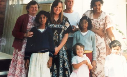 Amnesty Australia's Refugee Campaign Coordinator Shankar Kasynathan as a child with his mother and sisters and the family who sponsored them to stay in Australia