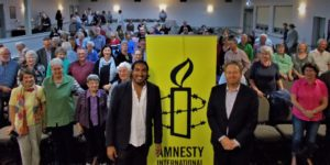 Refugee Campaigner Shankar and Davide Mann with the Wagga Wagga group behind them