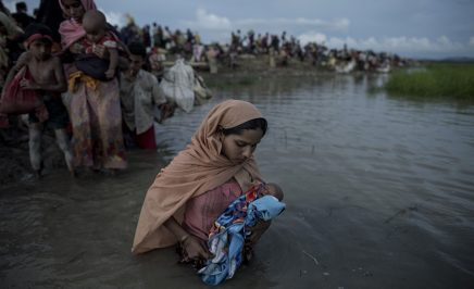 A Rohingya mother holds her baby in her arms