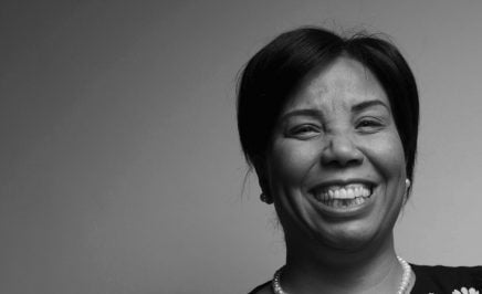 Black and white photo of Azza Soliman smiling into the camera.