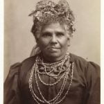 Sepia vintage photo of Fanny Cochrane Smith, Fanny Cochrane Smith wearing wattle in her hair and traditional shell necklace.