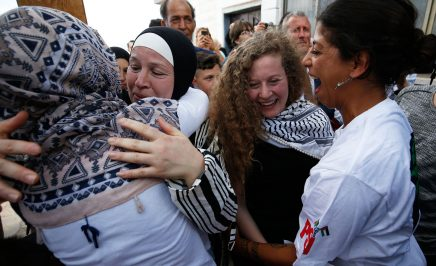 Ahed Tamimi greeting friends with her mother following her release from prison in the West Bank