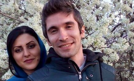 Human rights defenders Arash Sadeghi and Golrokh Ebrahimi Iraee smiling for the camera.