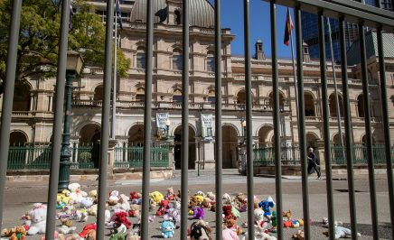 146 stuffed toys behind bars out the front of Queensland Parliament House. For each teddy there is a child under 14 behind bars in Queensland