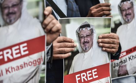Protestors hold pictures of missing journalist Jamal Khashoggi during a demonstration in front of the Saudi Arabian consulate on 8 October 2018.