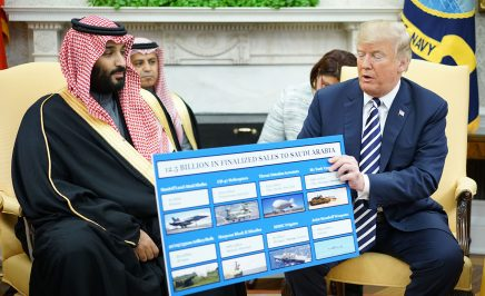 US President Donald Trump holds a defence sales chart with Saudi Arabia's Crown Prince Mohammed bin Salman in the Oval Office of the White House on 20 March 2018 in Washington DC.
