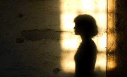 The silhouette of a women against light background.