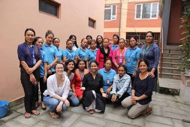 A group of women activists in Nepal smile for the camera.
