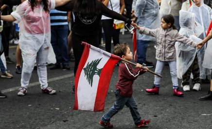 Young boy carries flag